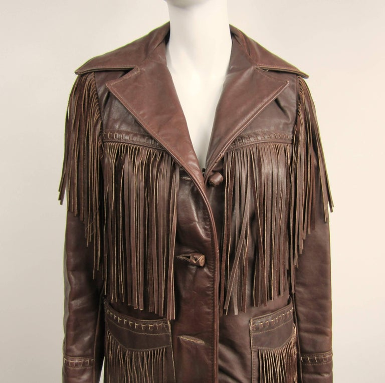 SCHOTT Leather Fringe Biker Jacket / Distressed. Dark Brown In color with Fringe all over this Vintage Leather Jacket. Pockets, Beast, Arm, Back all have fringe. Throw on a pair of Cowboy Boots and you are ready to go. 3 rolled leather buttons on