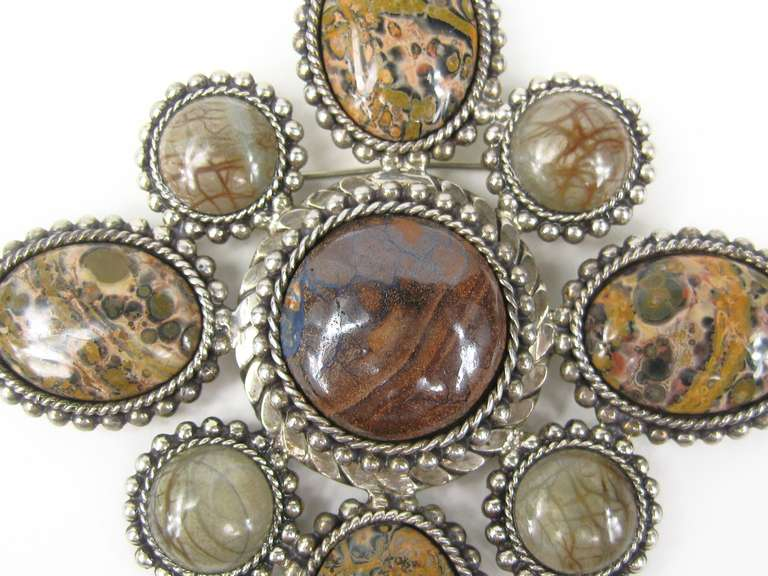 Stunning Dweck Brooch. Bezel set Jasper stones in sterling silver. Dated 1992. Hallmarked Stephen Dweck. Sterling silver. Measures 3.9 inches  H x 3.9 inches wide. This was purchased new, put away and never worn. This is out of a massive collection