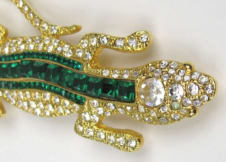 Stunning Green crystal Brooch by Valentino. Gold Gilt. Large in Scale- 4 3/8 in. L  x 2 in. W. This was purchased in the 1990s and stored away, never worn as is about 90% of our costume jewelry we have for sale on our store front. A lot  still have