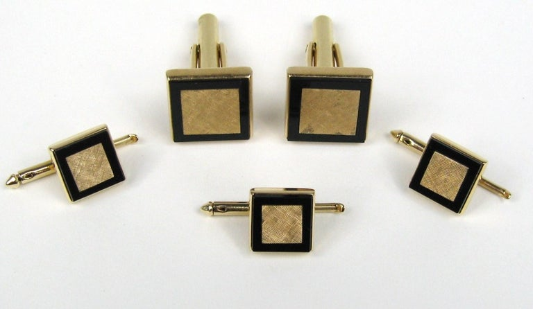 Brushed Gold Center with a black onyx surround. Handsome set of original Mid Century Cuff link- Shirt stud  Set. Included are Square Table cuff links, 3 Matching Shirt Studs .58 Square cuff-links .42 Square - on the studs. Hallmarked on the