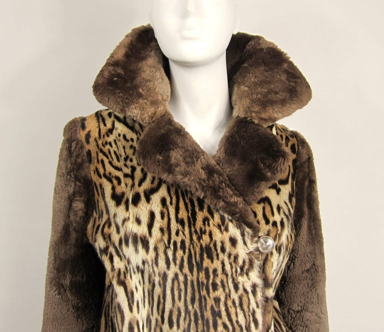 Wow. This is a stunning 1940s two fur jacket By M Blaustein of Short Hills. 2 slit pockets with 4 button closure that extends up to your neck. Monogrammed on the lining. Beige lining. Soft supple fur. Statement piece for sure. Will fit a 4-6 nicely,