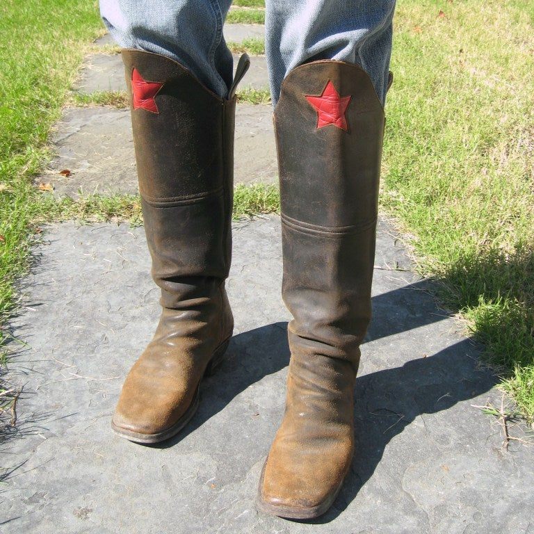 What a great pair Old Vintage Calvary Boots. These boot are thick leather with that great RED star front and center. Large straps to pull them on with. Inside of the boot front is lined with that rich red leather. Men size 11. 16.5 inches up the