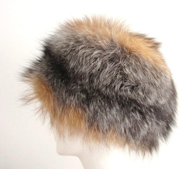 Fox Fur hat. Combination of Red and SIlver for.  This is a 22.5 in. Soft and supple  We have more fox hats listed.  Please be sure to check our storefront for more furs from Mink, Fitch, Fox and Lamb. We also have hundreds of pieces of jewelry from