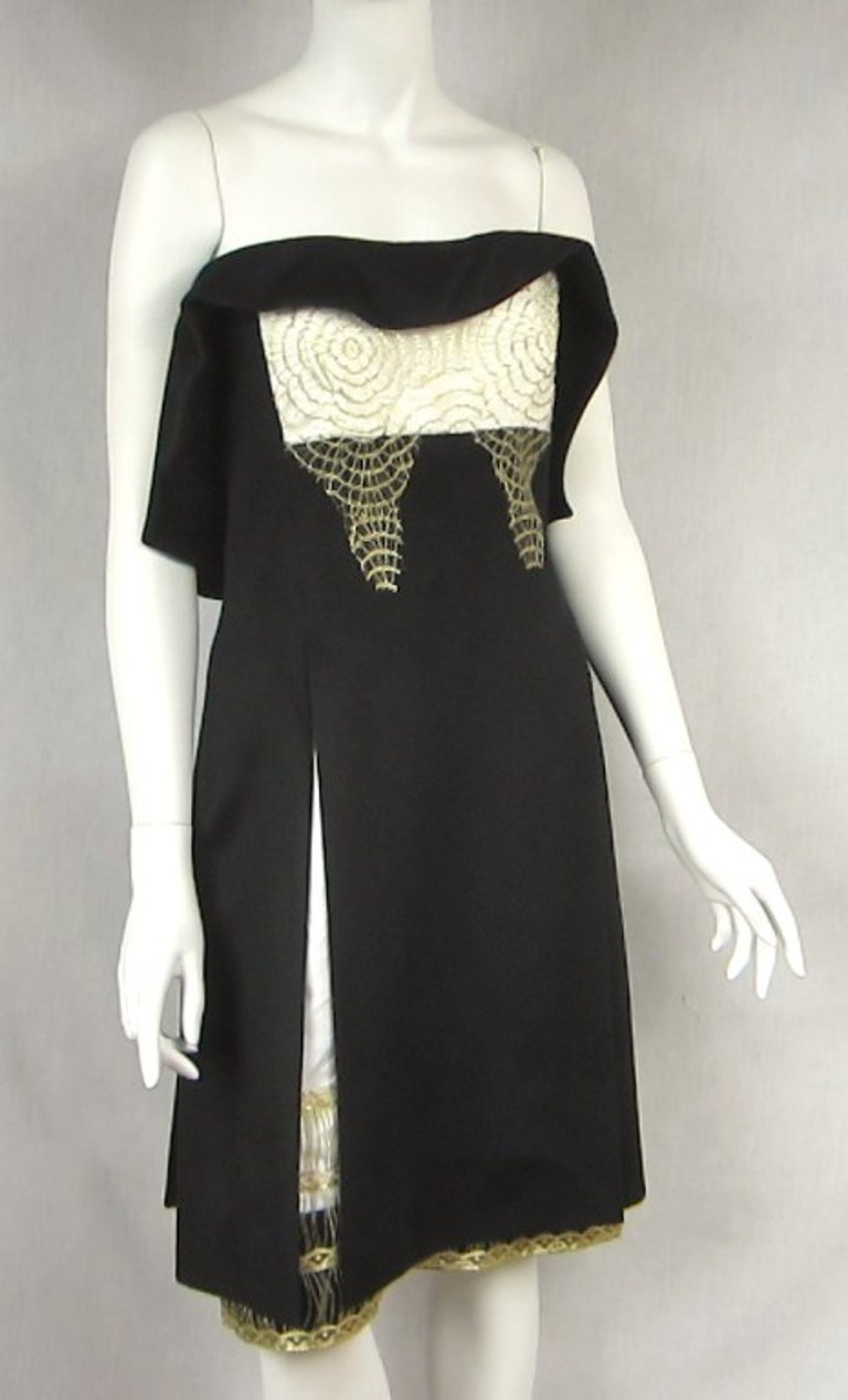 YSL 100% Cashmere Little Black Dress with oh so much detailing Spiderweb Gold Appliques. Double zippered back. Hidden pockets in the front. Will fit a small. Please be sure to check our storefront for more fashion as we have both Vintage and