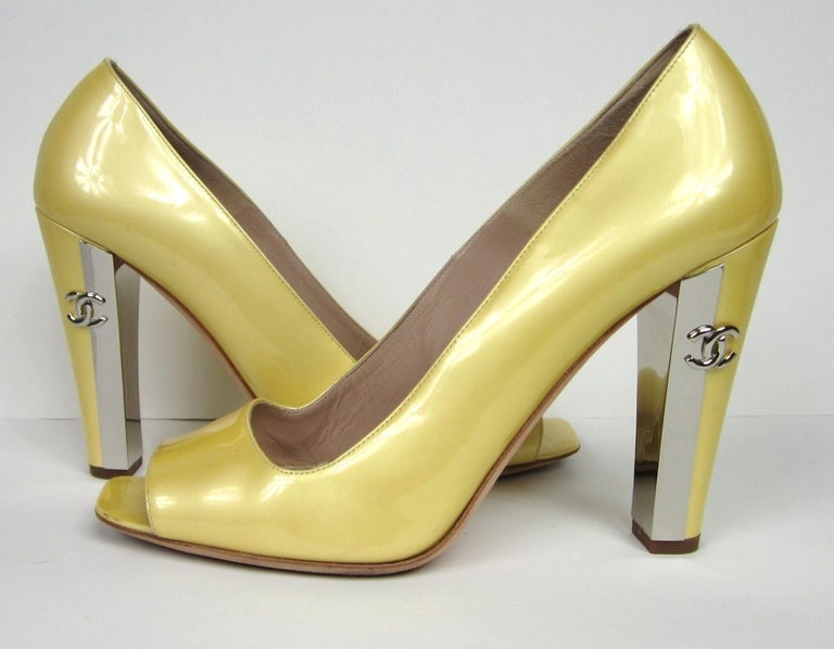 Chanel Pearl Yellow Shoes *Made in Italy. Stunning Silver metal Heels with CC log on each one. Comes with Dust bags. No Box. 39.5 - 4 inch  high heel. Please be sure to check our storefront for more fashion as we have both Vintage and Contemporary
