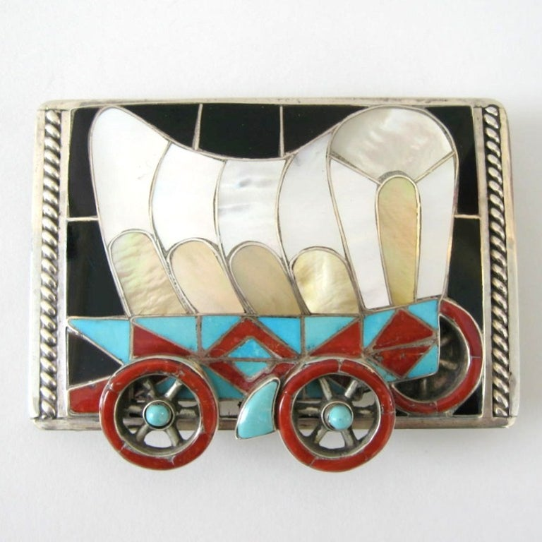 Just stunning. The amount of work that went into this masterpiece is amazing. Covered wagon with movable wheels. Silversmiths, Helen and Lincoln Zunie are masters in their craft and this piece shows you why.  This buckle will accommodate a belt up