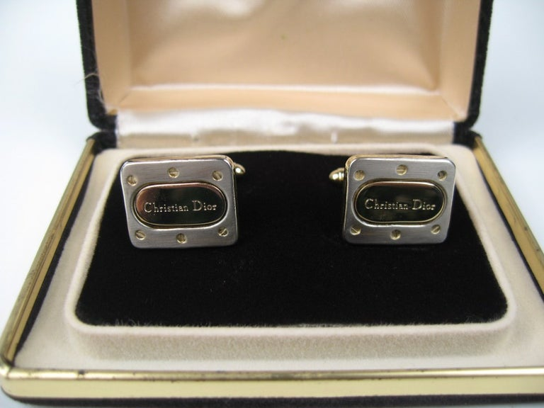 Pair of Christian Dior Cuff links, with the original box. Measuring .65in x .79in. This is out of a massive collection of Hopi, Zuni, Navajo, Southwestern and sterling silver jewelry from one collector. Be sure to check our store front for more