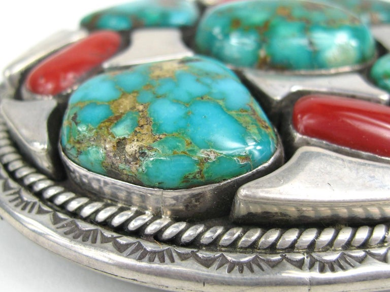This stunning piece made by Navajo artisan Vandever is made up of huge pieces of Turquoise and coral. This measures 3.53 x 2.88 inches and Hallmarked on the back. This is out of a massive collection of Hopi, Zuni, Navajo, Southwestern and sterling
