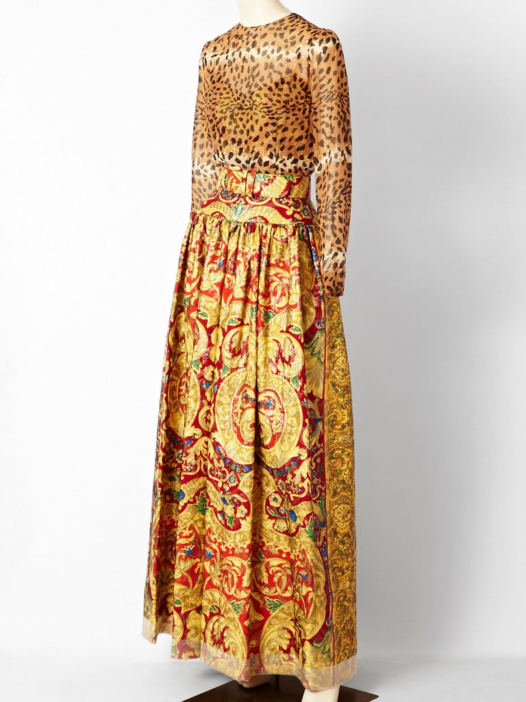 Bill Blass, evening gown with leopard print, long sleeve, top and dropped waist skirt with a floral, brocade, baroque print skirt and matching belt.