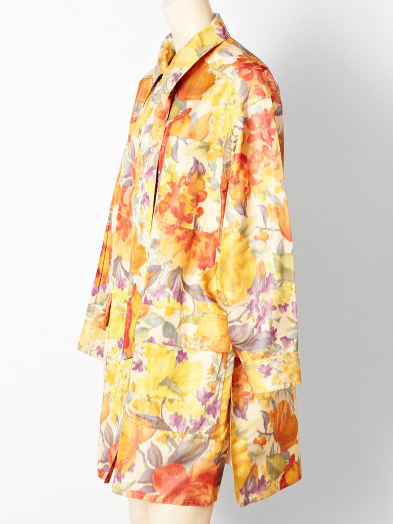 Bill Blass, floral print, chine taffeta, light weight, spring, 3/4 coat with large flap pockets and one breast pocket. Side slits creating a casual shirt like mood. Buttons are hidden.