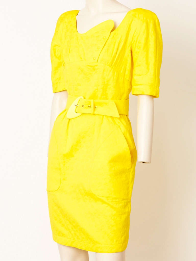 Thierry Muglar chrome yellow, cotton jacquard, fitted, belted dress with deep big pockets and asymmetric neckline. Signature Muglar,  back snap closures.