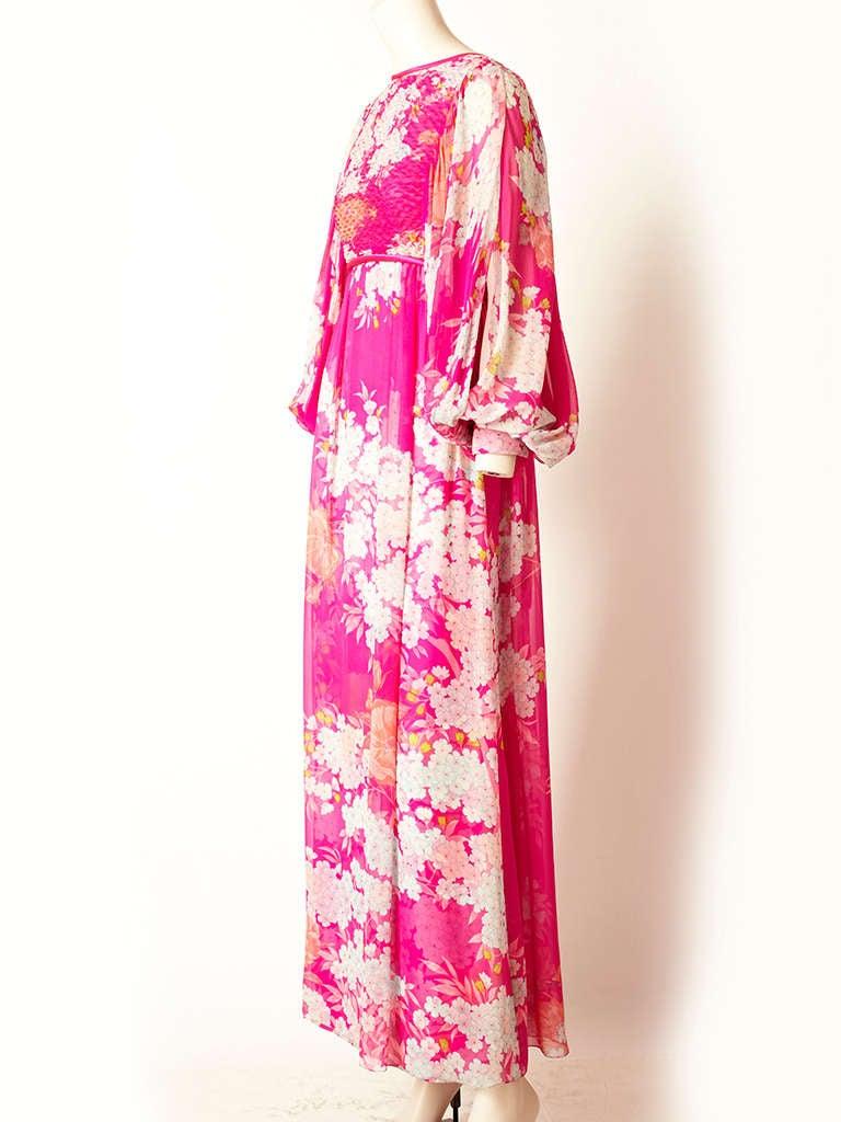 Hanae Mori, fuchsia,  Asian inspired print, chiffon, dress with a smocked bodice. Full, sheer, long sleeves that cuff at the wrist.