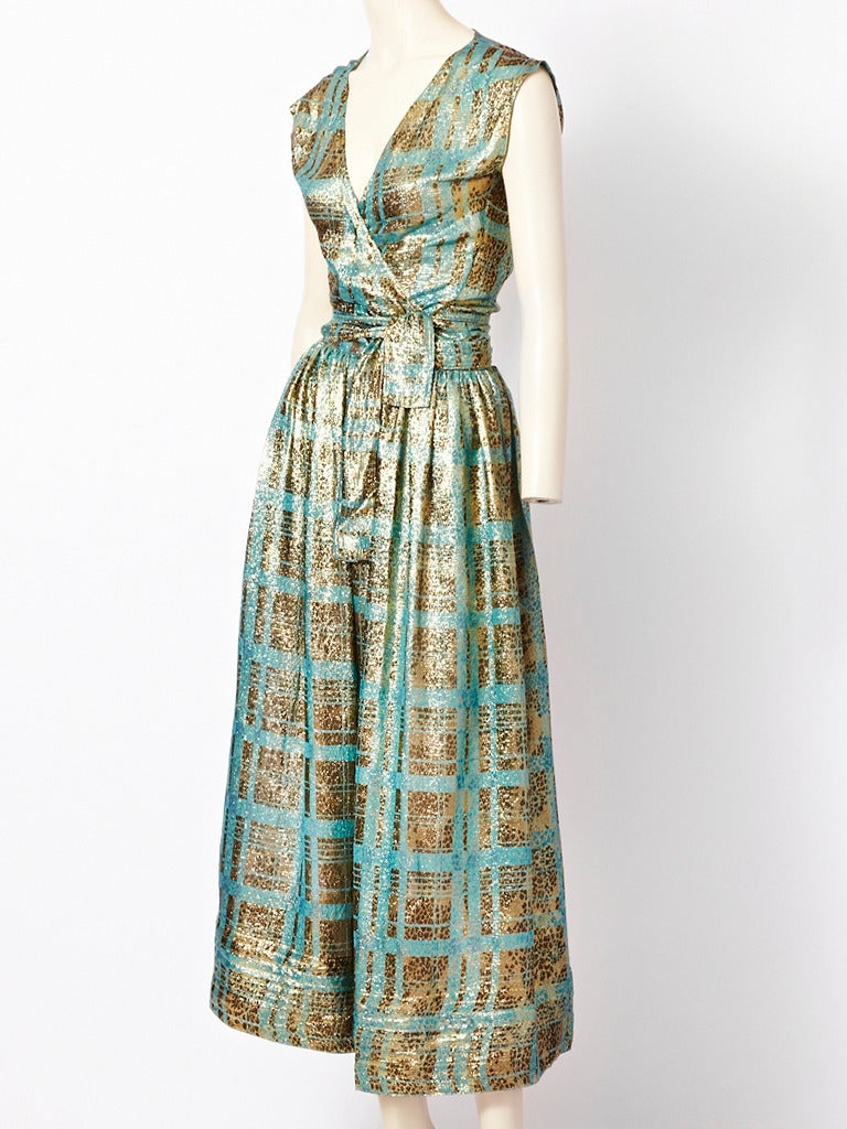 Geoffrey Beene, gold and turquoise, metallic, top and skirt ensemble. Wrap top has short sleeves and ties around the waist. Skirt is gathered at the hip with a waist band. Beautiful fabric.