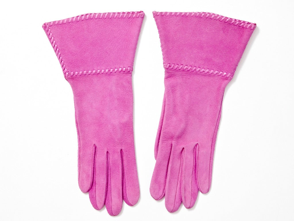 Yves Saint Laurent, fuchsia, suede gauntlet gloves trimmed in leather diagonal stitching.