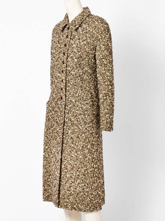 "Valentino, brown, fitted, ""princess style"", tweed coat, having a small pointed collar and a raglan sleeve. Side pocket detail."