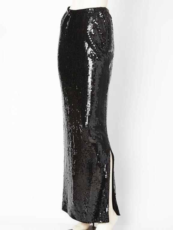 Bill Blass, long, black, sequined, straight evening skirt with a deep side slit on the left side. Zipper, closure on the left. Lined in silk.