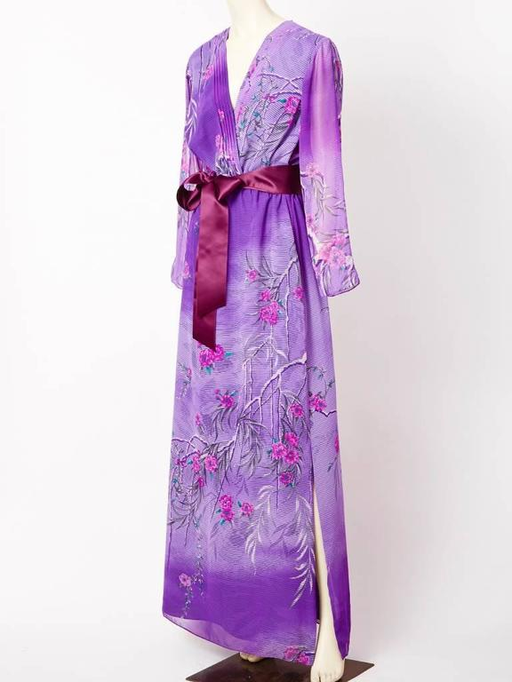 Hanae Mori, purple, poly chiffon, Japanese inspired, floral branches pattern, deep V neck gown. Long sheer sleeves, slightly gathered waist having a satin tie. Straight skirt with a deep side slit.