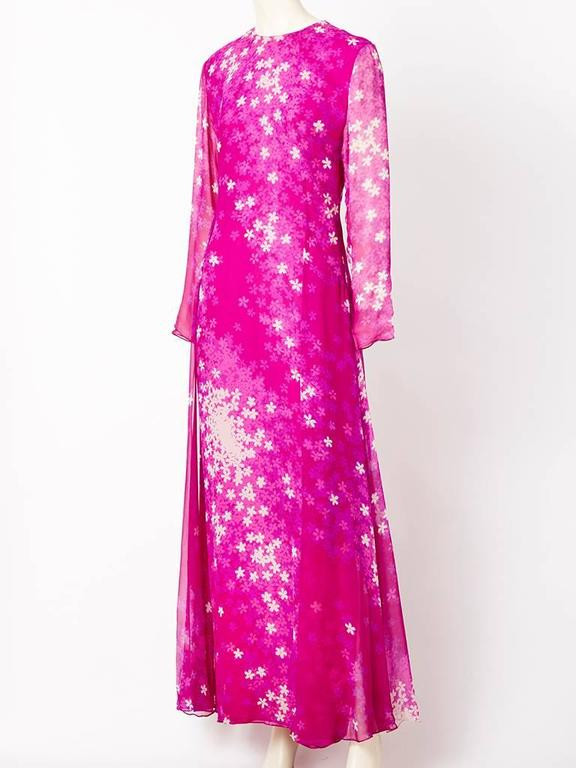 Hanae Mori, floral print, chiffon gown in shades of pinks, having a jeweled neckline, long sheer, sleeves and semi fitted silhouette having side panels that extend to the back . Back detail of the dress is dropped at the waist with gathering  adding