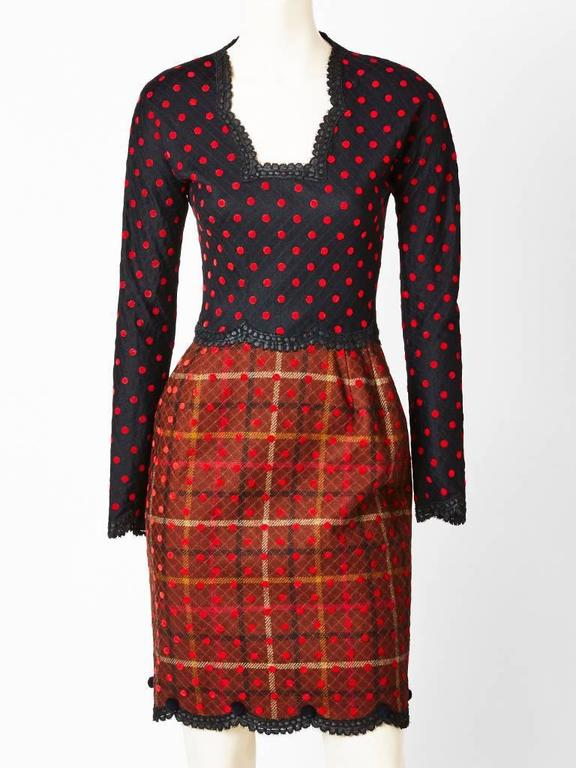 Geoffrey Beene, quilted, wool, plaid and polka dot jacket and dress ensemble. Dress has a fitted bodice, long sleeves, and an open neckline. Bodice has a black and red polka dot fabric with lace trim detail.Skirt of the dress is slightly gathered