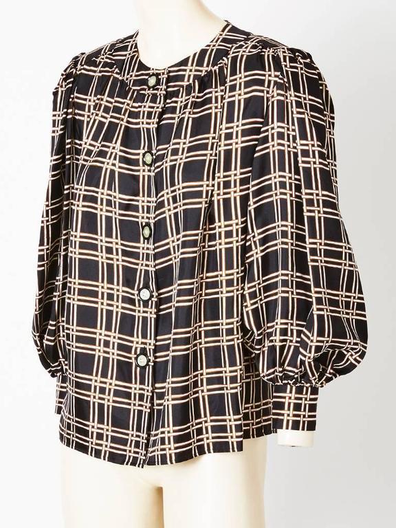 Yves Saint Laurent, silk twill , smock style blouse having a