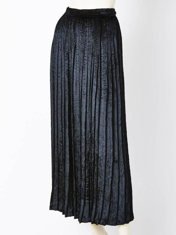 Yves Saint Laurent, black, crushed, panne, velvet, accordion pleated, long skirt. Narrow waistband with a side zipper closure.