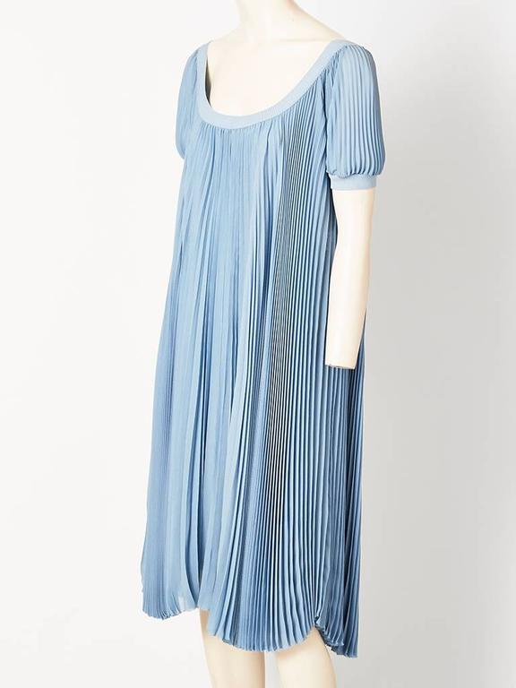 Martin Margiela  for Hermes, dusty blue, silk georgette, pleated, smock dress. having a scoop neckline and a short, puff sleeve. Neckline and sleeves are edged in a silk knit. Dress comes with a georgette bias cut underpinning of the same color.