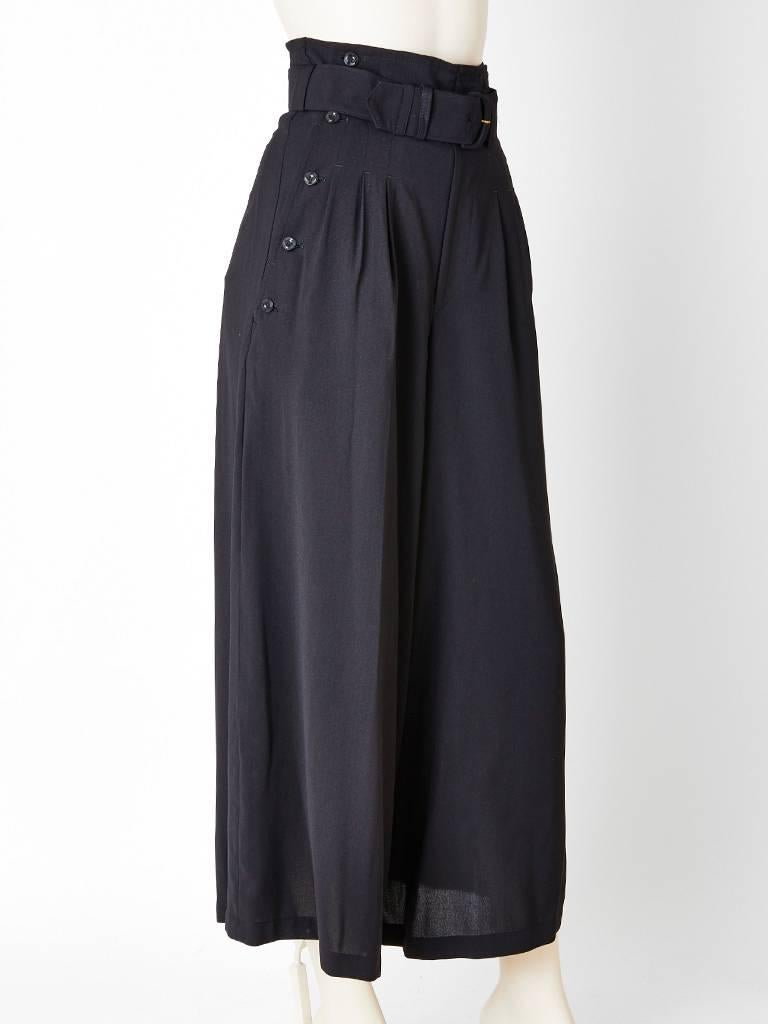 Matsuda, high waisted, belted, wide leg trousers, having sailor style side button detail at each hip. Fly front, men's style with pleats at the hip.