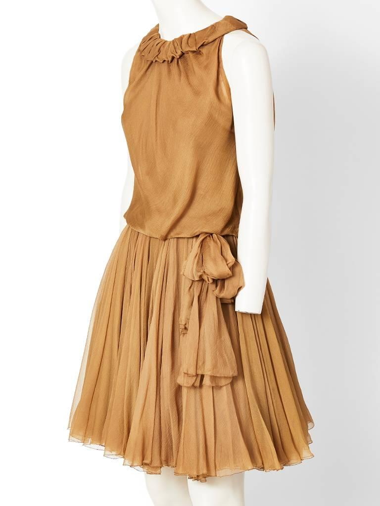 Galanos, taupe tone, multilayered silk georgette, cocktail dress, having a halter cut sleeve, a soft ruffled neckline, and a bodice that is slightly blouson. Skirt is gathered with multiple layers of bias cut chiffon...This dress was specially made