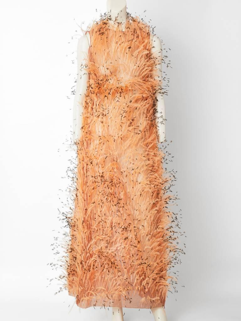 Balenciaga, nude tone, sleeveless A line, long gown, made of a silk organza encrusted with ostrich feathers of the same tone.  The feathers have brown tips. The slip to this dress is missing where one would see the Balenciaga label. The gown has a