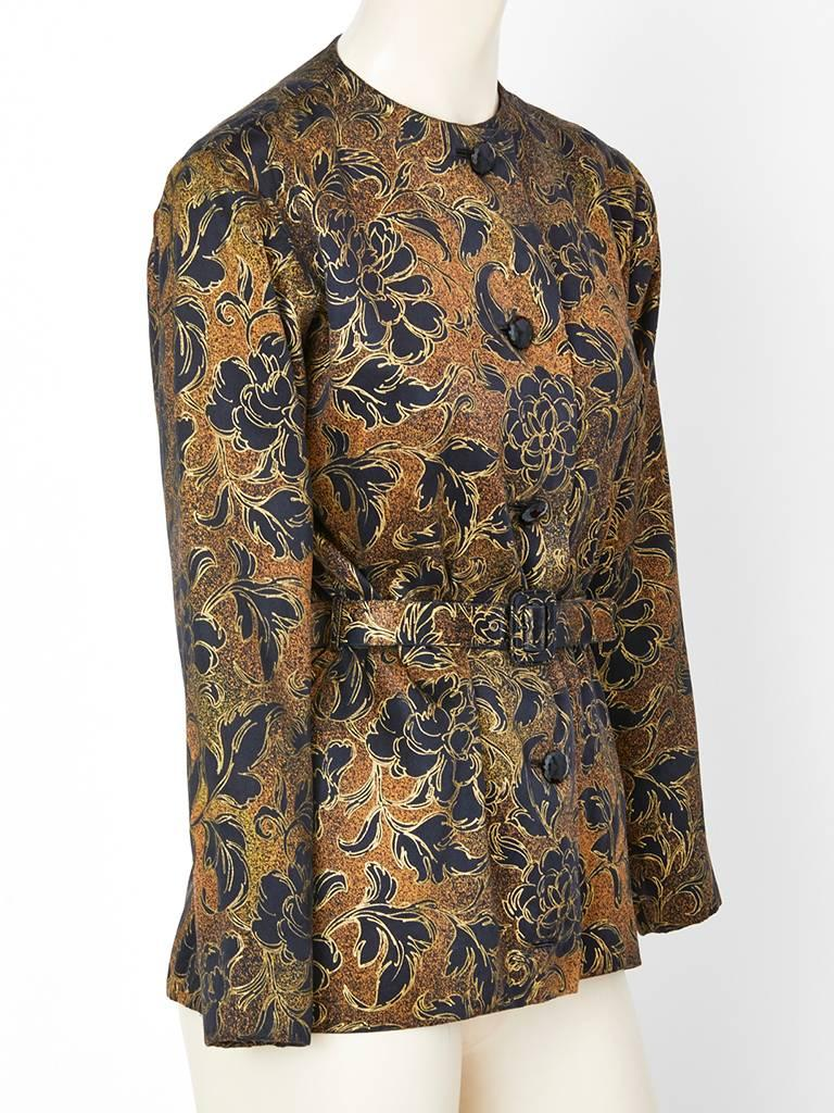 Yves Saint Laurent Couture, floral pattern in a copper tone, with gold detail, collarless belted , semi fitted  evening  jacket. Black faceted jet button closures.