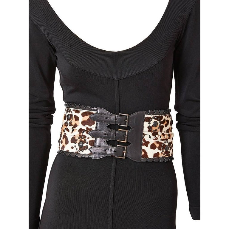 Azzedine Alaia, stenciled leopard, pattern on pony skin wide ( corset ) belt having studded brass embellishment and leather laced edging with triple buckle closure.