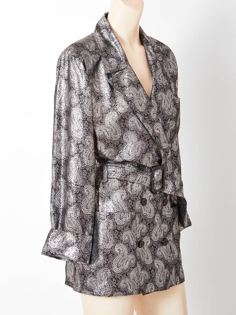 Jean Louis Scherrer, double breasted, silver lamé, silk, paisley pattern, belted evening jacket / trench, having deep side pockets and wide lapels.