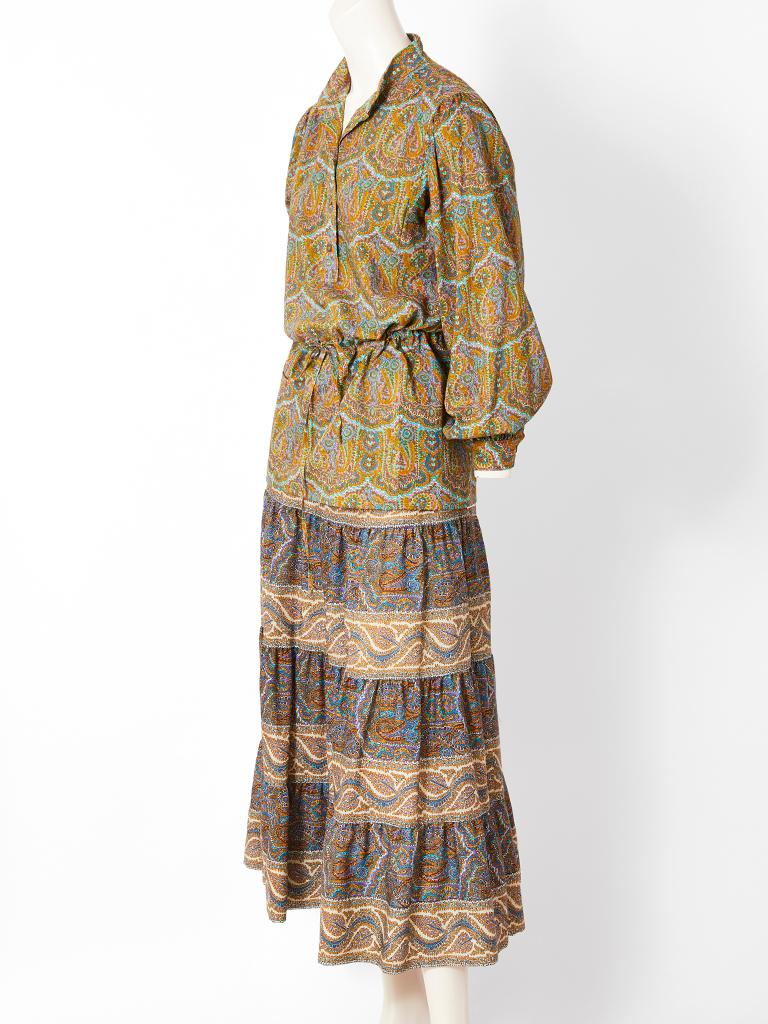 Yves Saint Laurent, wool Challis, paisley pattern skirt and top in shades of greens, and blues. Top has a mandarin collar,with a button front and drawstring waist, which can be worn as tunic. Gathered skirt has an elastic waist,  with several tiers