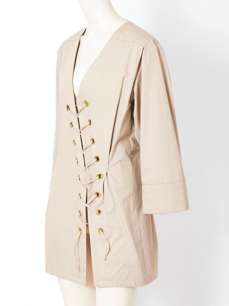 Yves Saint Laurent, Rive Gauche, Khaki, safari tunic with a V neckline and diagonal lacing detail, c. !980's.