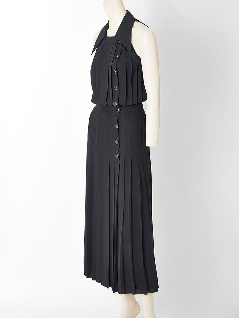 Karl Lagerfeld, black crepe, vertically, pleated maxi dress, having halter cut sleeves,  a pointed collar and  front side button closures.
