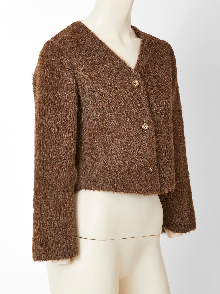 Geoffrey Beene, rust tone, mohair jacket, having a v neck with a 3 button front closure. Interior has a complementing  brown and beige tweed lining. C. Early 1980's.