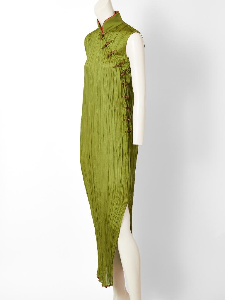 John Galliano, for Christian Dior, moss green, silk plissé, dress inspired by Mariano Fortuny and the traditional Chinese Cheongsam.  It's a successful marriage of both influences. Dress has a mandarin collar trimmed in red with gold lame side frog