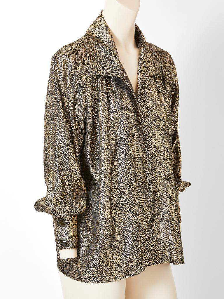 Yves Saint Laurent, Rive Gauche, reptile pattern, gold lame, shirt/blouse having a stand up collar, balloon sleeves that end in a cuff and no front closures. Top can be worn as a jacket or as a blouse wrapped with a belt. c.late 70's.