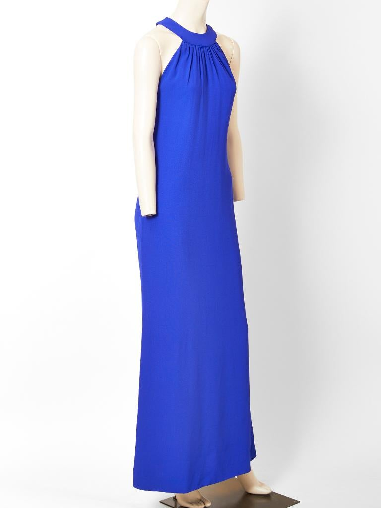 Yves Saint Laurent, Rive Gauche, cobalt blue, semi fitted gown, having halter cut sleeves, with a gathered collar neckline. Dress is made of a viscose satin back crepe.