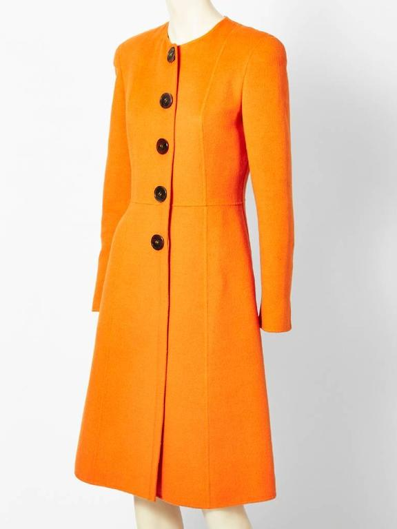 Valentino, tangerine, color, double face wool, fitted,collarless coat. Wool and cashmere blend...