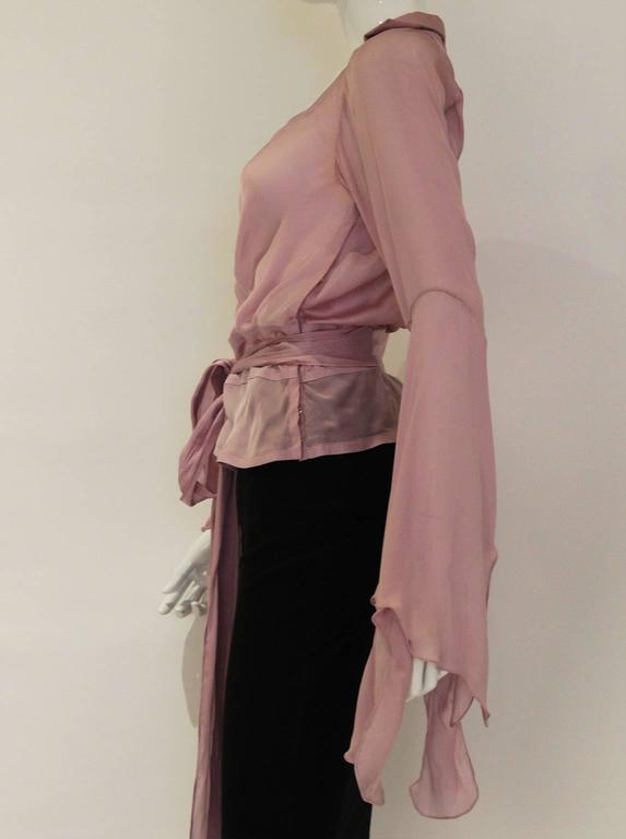 A beautiful blouse by Yves Saint Laurent, Rive Gauche, in fine lavender colour silk. This blouse has a sweetheart neckline with gathering detail and long sleeves with wonderful waterfall effect from the elbow. It also has a long tie belt that goes