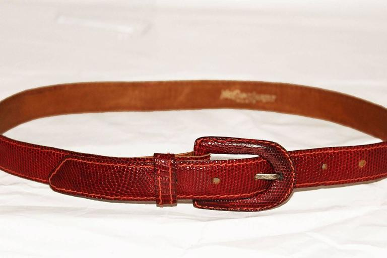 This Yves Saint Laurent, Paris belt will be a bright addition to any wardrobe.In a lovely deep red colour,the belt has an elegant oval buckle , one belt loop,and six notches.