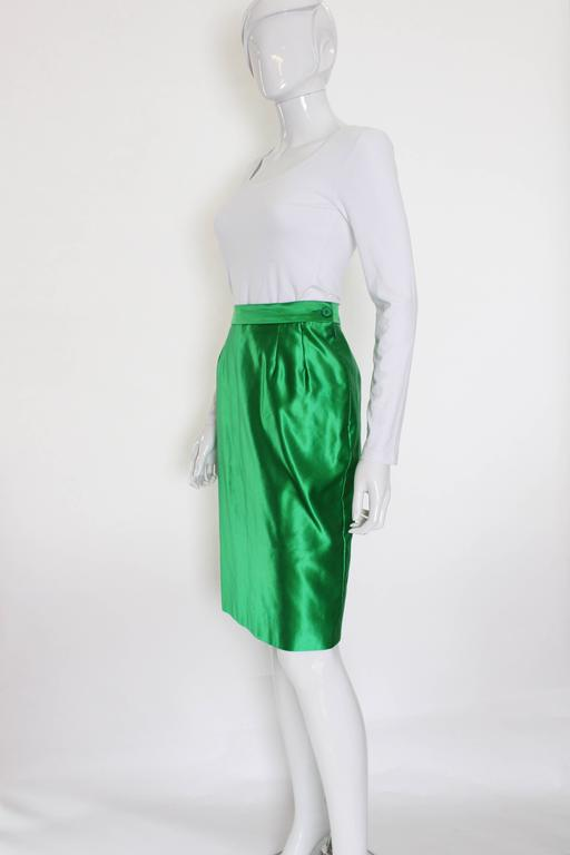 A great green skirt from Yves Saint Laurent,Variatio line. This skirt is a wonderful colour ,and in a great fabric being, 70% cotton, 30% silk.The skirt has a side zip opening,and a 6'' slit at the back.
