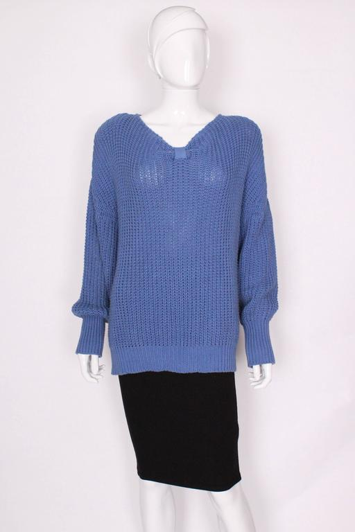 A great casual jumper for the last days of Summer. In an easy to wear heavy weight cotton, this jumper has all the style and quality you would expect from Jean Muir. The jumper is a pretty cornflower blue colour, with a v neck and  3'' of narrow