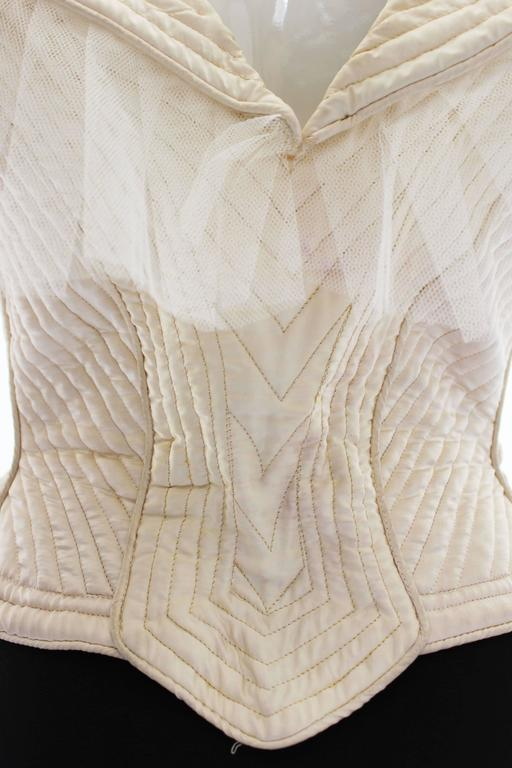 1970s Ivory Quilted Satin Corset Style Vintage Waistcoat by Penny Green In Excellent Condition For Sale In London, GB