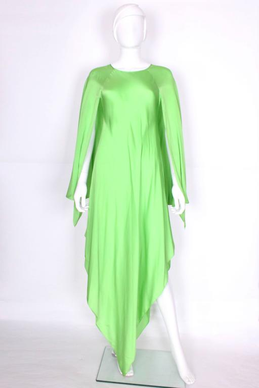 This green silk gown, by the late US designer Oscar de la Renta, is a real head turner. In a super soft silk ,  with angel sleeves and a pointed hem, it is easy to wear and accessorize.