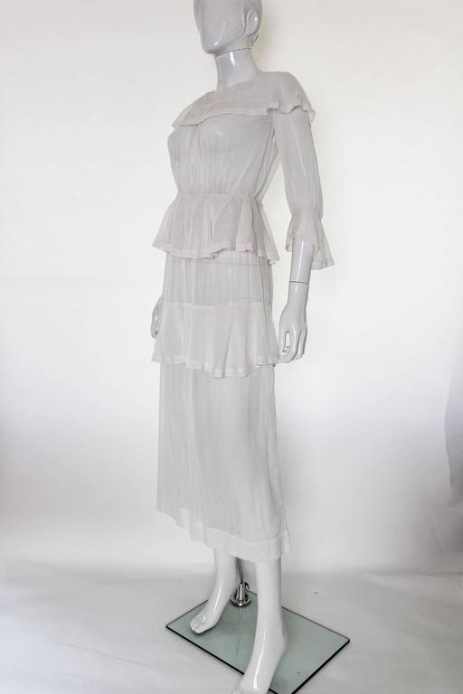 This is truely an amazing piece, especially for its age. It is in near perfect condition with no holes, tears or blemishes of any kind. The skirt is a single layer of soft raw cotton that is covered in thicker flecks of thread which cover the whole