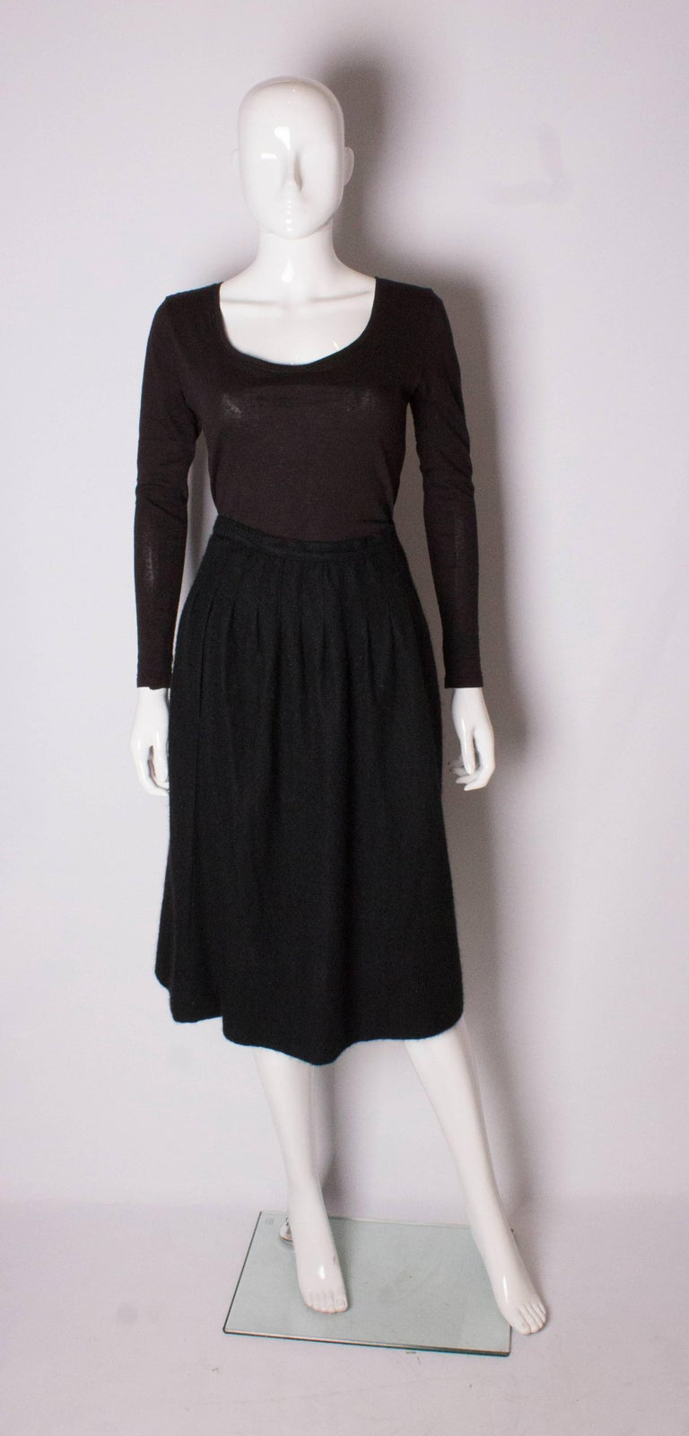 A cosy cashmere skirt by Yves Saint Laurent Rive Gauche. The skirt is unlined, and has pleats on the front  and back. The skirt has a zip opening on the left hand side.