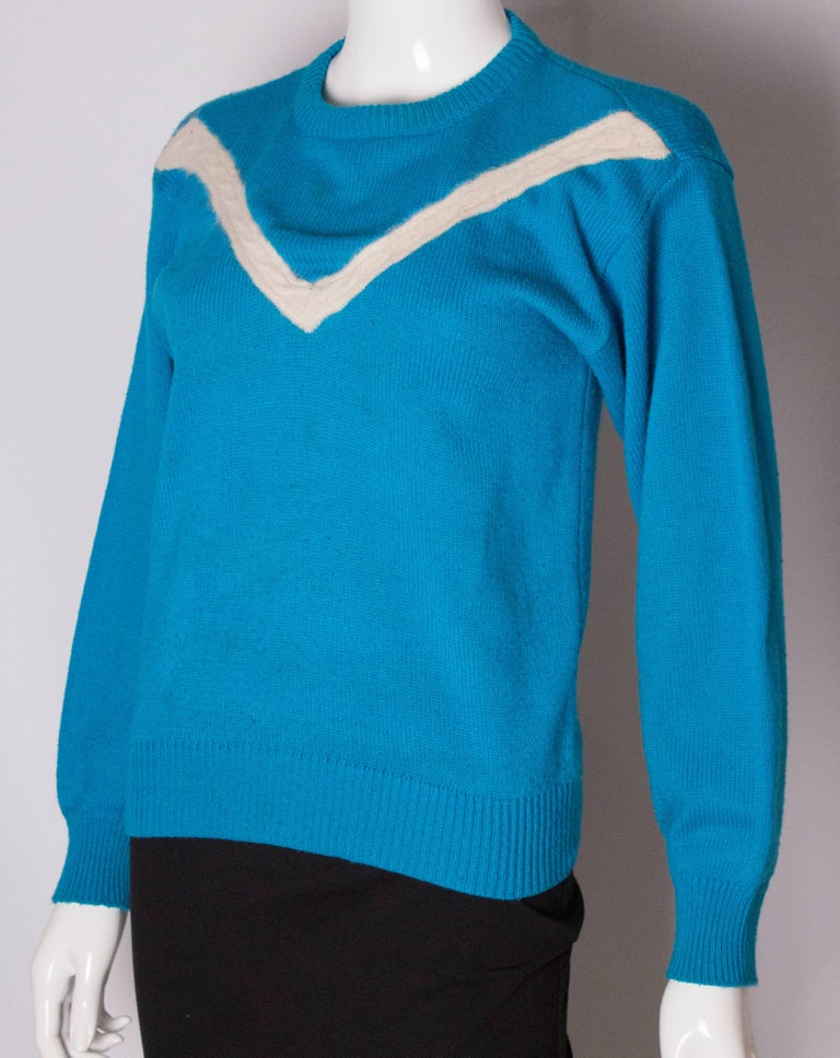 a368ddfed1a A fun jumper by Yves Saint Laurent , Active Wear. The jumper has a round