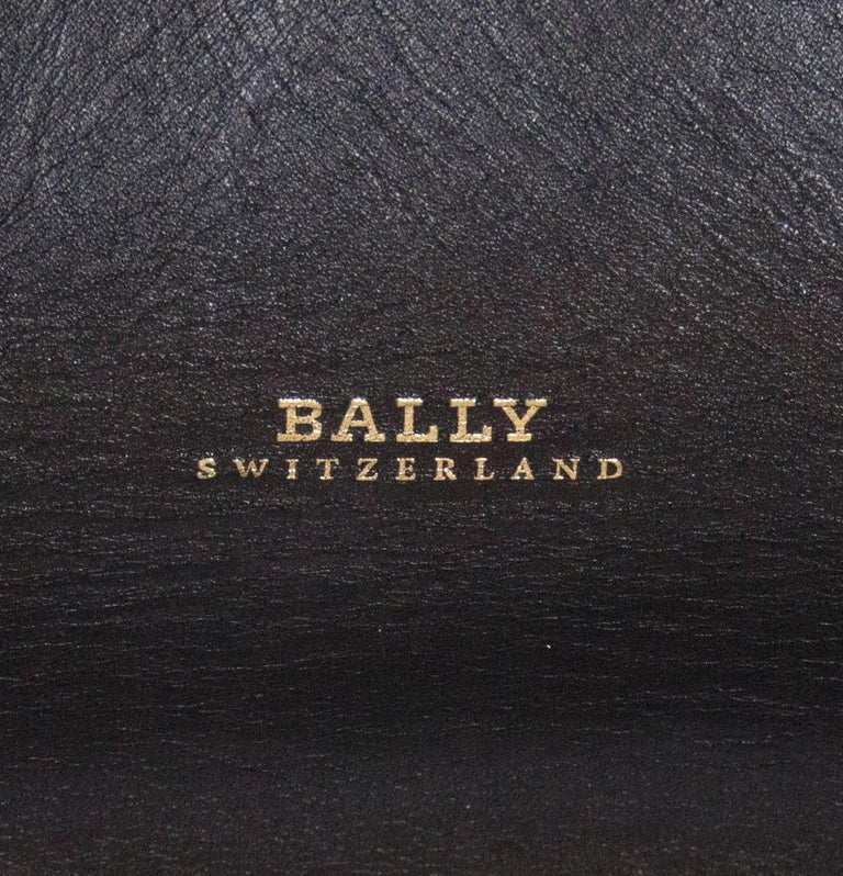 A soft leather bag by Bally . The bag as 2 large handles and 2 small handles and can be worn as a shoulder bag or hand bag. It has a lined base, and the dimensions are : base 10'' x 11'', height  15''.